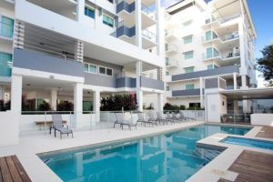 Pool area at Arriva Apartments
